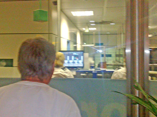 Man watches personal information displayed on screen
